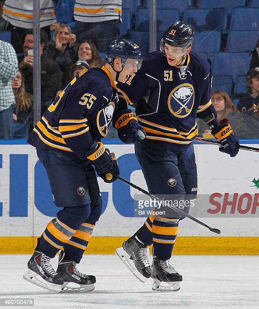 Rasmus Ristolainen of the Buffalo Sabres celebrates a goal with Nikita Zadorov against the Ottawa Senators on December 15 2014 at the First Niagara...