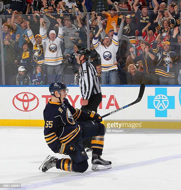 Rasmus Ristolainen of the Buffalo Sabres celebrates after scoring the game winning goal against the Vancouver Canucks during an NHL game on November...