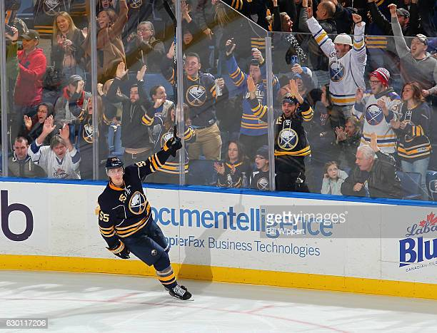 Rasmus Ristolainen of the Buffalo Sabres celebrates his gamewinning overtime goal against the New York Islanders during an NHL game at the KeyBank...