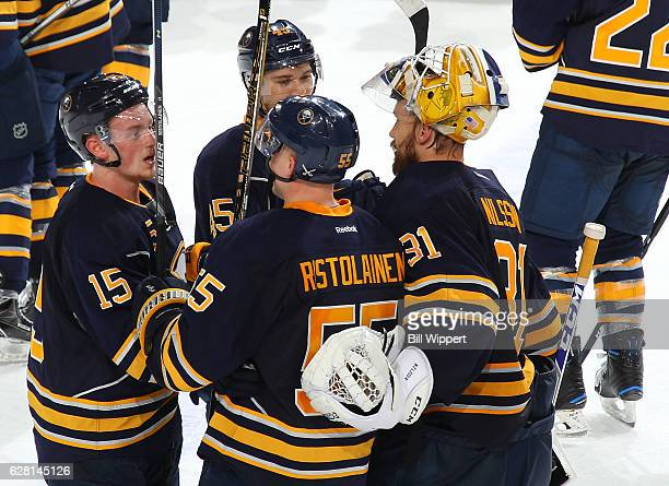 Rasmus Ristolainen of the Buffalo Sabres celebrates with Jack Eichel Brendan Guhle and Anders Nilsson after his gamewinning overtime goal against the...