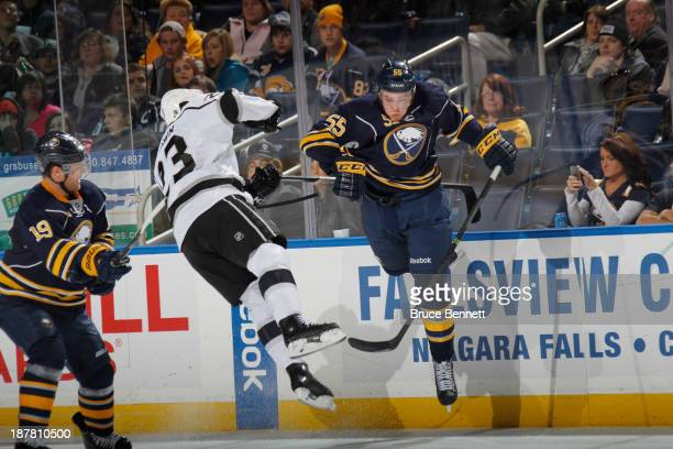 Rasmus Ristolainen of the Buffalo Sabres checks Dustin Brown of the Los Angeles Kings during the third period at the First Niagara Center on November...