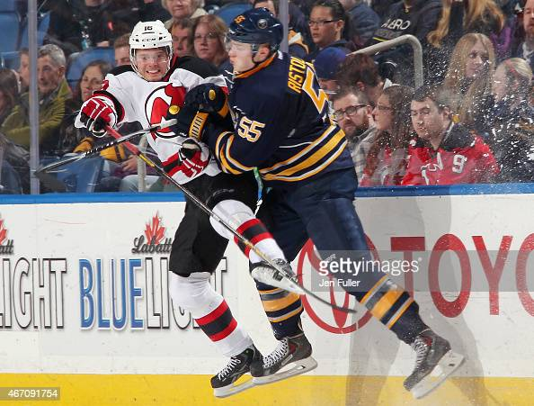 Rasmus Ristolainen of the Buffalo Sabres checks Jacob Josefson of the New Jersey Devils at First Niagara Center on March 20 2015 in Buffalo New York...
