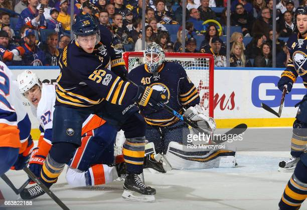 Rasmus Ristolainen of the Buffalo Sabres clears the puck out of the zone against the New York Islanders in front of goaltender Robin Lehner during an...