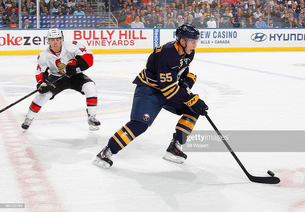 Rasmus Ristolainen #55 of the Buffalo Sabres controls the puck against Jean-Gabriel Pageau #44 of the Ottawa Senators on October 4, 2013 at the First Niagara Center in Buffalo, New York.