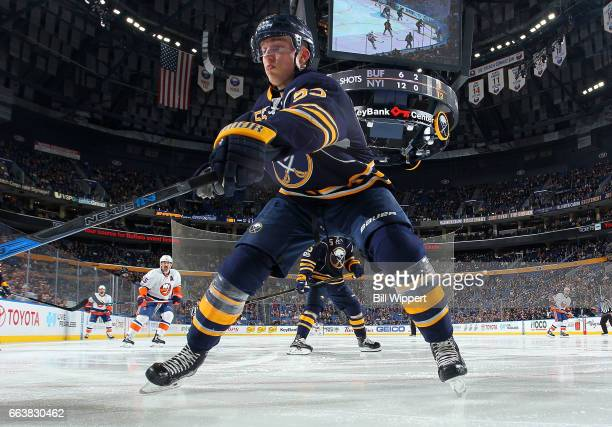 Rasmus Ristolainen of the Buffalo Sabres defends against the New York Islanders during an NHL game at the KeyBank Center on April 2 2017 in Buffalo...