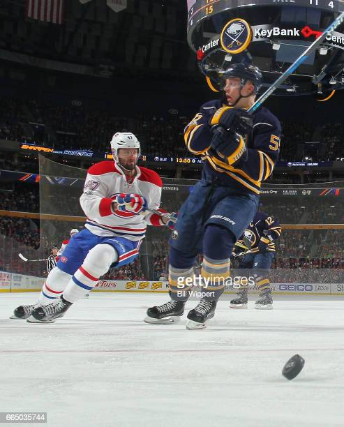 Rasmus Ristolainen of the Buffalo Sabres eyes Alexander Radulov of the Montreal Canadiens during an NHL game at the KeyBank Center on April 5 2017 in...
