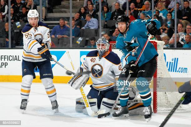 Rasmus Ristolainen of the Buffalo Sabres goes to deflect the puck as Robin Lehner of the Buffalo Sabres and Jannik Hansen of the San Jose Sharks...