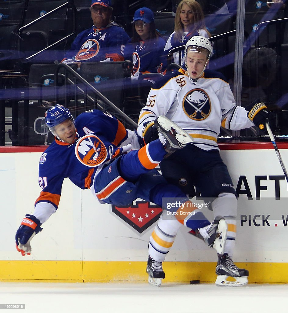 Rasmus Ristolainen of the Buffalo Sabres hits Kyle Okposo of the New York Islanders during the second period at the Barclays Center on November 1...