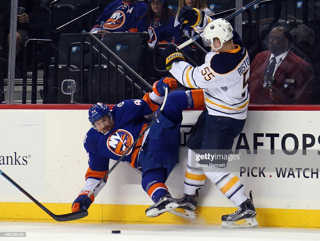 Rasmus Ristolainen of the Buffalo Sabres hits Mikhail Grabovski of the New York Islanders during the second period at the Barclays Center on November...