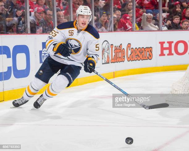 Rasmus Ristolainen of the Buffalo Sabres skates after a loose puck against the Detroit Red Wings during an NHL game at Joe Louis Arena on March 20...