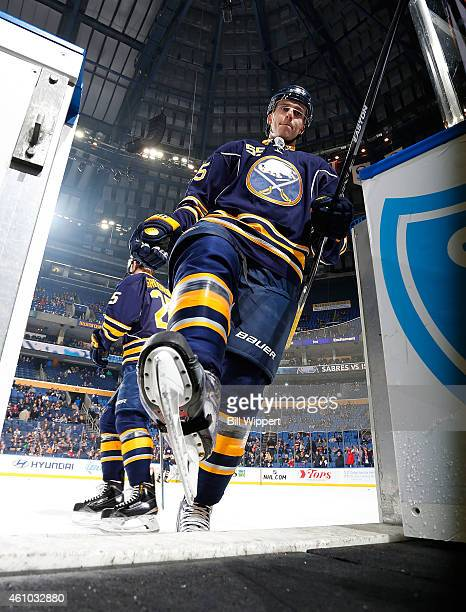 Rasmus Ristolainen of the Buffalo Sabres steps from the ice before a game against the New York Islanders on December 27 2014 at the First Niagara...