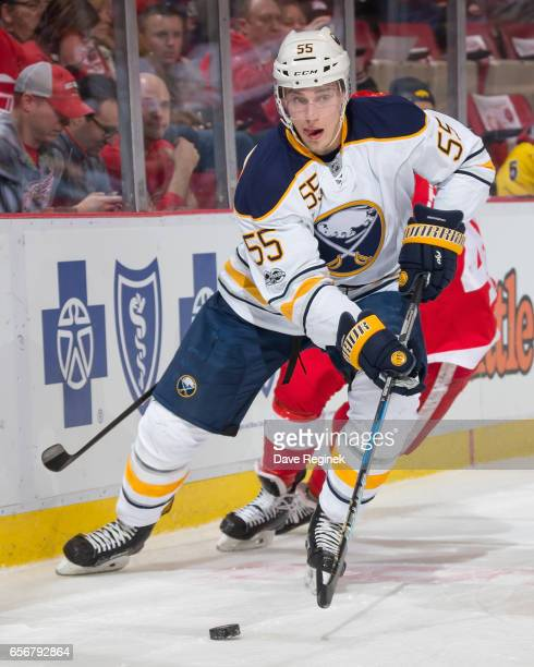 Rasmus Ristolainen of the Buffalo Sabres turns up ice with the puck against the Detroit Red Wings during an NHL game at Joe Louis Arena on March 20...