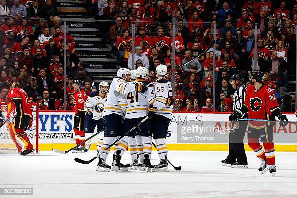 Rasmus Ristolainen Zach Bogosian and teammates of the Buffalo Sabres celebrate a goal against the Calgary Flames during an NHL game at Scotiabank...