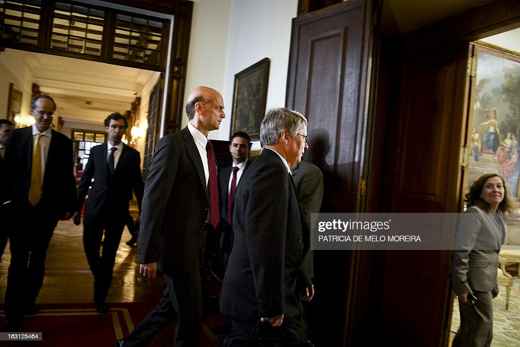 Rasmus Ruffer, head of the European Central Bank (ECB) delegationto Portugal, Jurgen Kroger, head of European Union (EU) delegationn (EU) arrive for a meeting with the President of the Portuguese Parliament Assuncao Esteves in Lisbon on March 05, 2013. AFP PHOTO / PATRICIA DE MELO MOREIRA