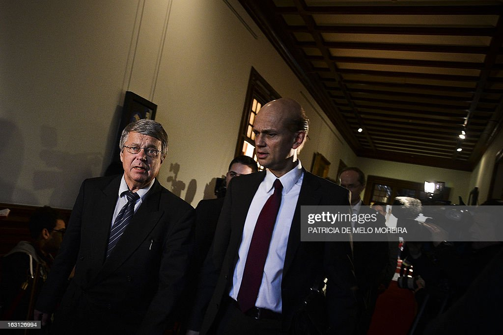 (Rasmus Ruffer (R), head of the European Central Bank (ECB) delegationto Portugal and Jurgen Kroger, head of European Union (EU) delegationn (EU) leave after a meeting with the President of the Portuguese Parliament Assuncao Esteves (unseen) in Lisbon on March 5, 2013.