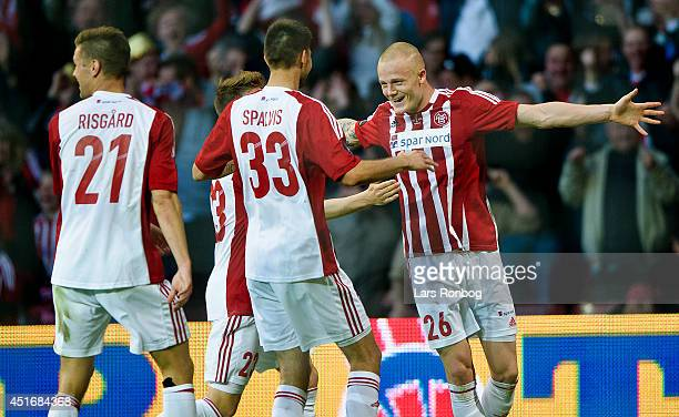 Rasmus Thelander of AaB Aalborg celebrates scoring his team's second goal with his teammates during the DBU Pokalen Cup Final match between AaB...