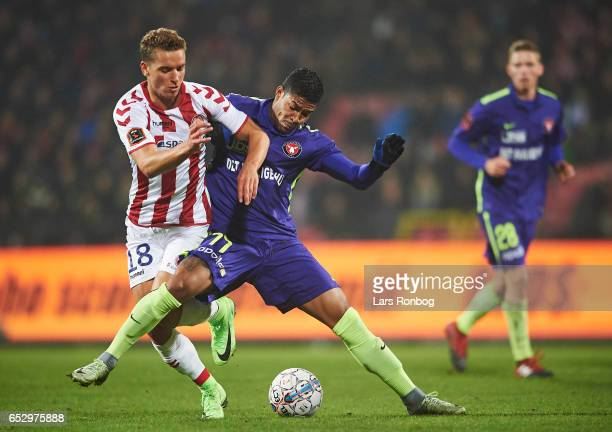 Rasmus Thellufsen of AaB Aalborg and Bruninho of FC Midtjylland compete for the ball during the Danish Alka Superliga match between AaB Aalborg and...