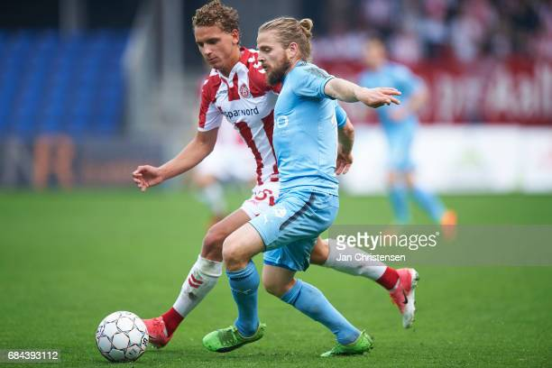 Rasmus Thellufsen of AaB Aalborg and Kasper Fisker of Randers FC compete for the ball during the Danish Alka Superliga match between Randers FC and...