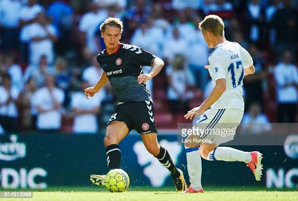Rasmus Thellufsen of AaB Aalborg and Kasper Kusk of FC Copenhagen compete for the ball during the Danish Alka Superliga match between FC Copenhagen...