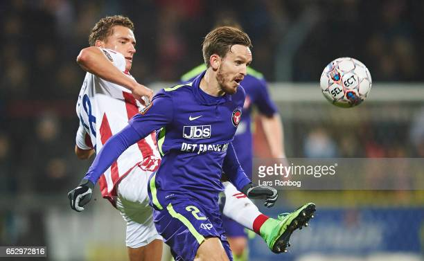 Rasmus Thellufsen of AaB Aalborg and Kian Hansen of FC Midtjylland compete for the ball during the Danish Alka Superliga match between AaB Aalborg...