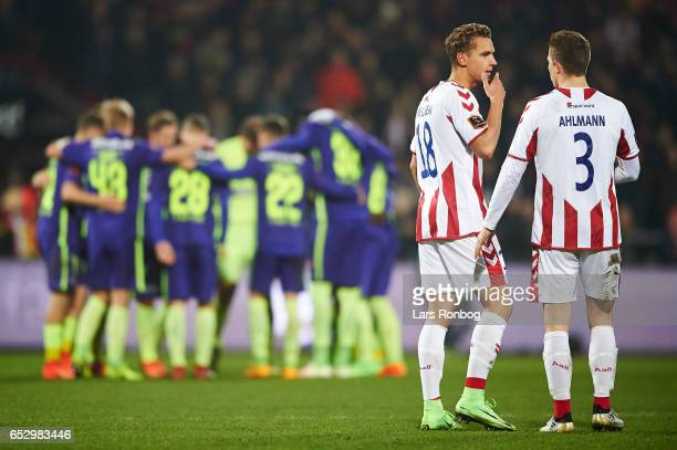 Rasmus Thellufsen speaks to Jakob Ahlmann of AaB Aalborg during halftime in the Danish Alka Superliga match between AaB Aalborg and FC Midtjylland at...