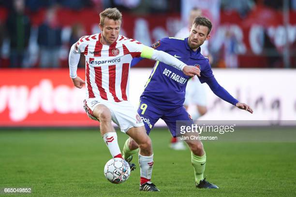 Rasmus Würtz of AaB Aalborg and Janus Drachmann of FC Midtjylland compete for the ball during the Danish Cup DBU Pokalen Quarterfinal match between...