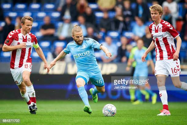 Rasmus Würtz of AaB Aalborg Kasper Fisker of Randers FC and Magnus Christensen compete for the ball during the Danish Alka Superliga match between...