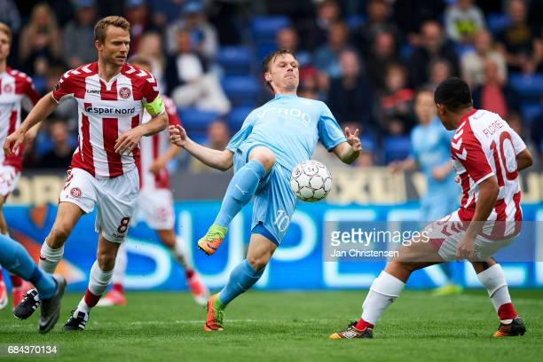 Rasmus Würtz of AaB Aalborg Marvin Pourié of Randers FC and Edison Flores of AaB Aalborg compete for the ball during the Danish Alka Superliga match...