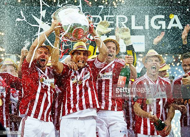 Rasmus Würtz Thomas Augustinussen Kenneth Emil Petersen and Kasper Risgård of AaB Aalborg lifts the trophy after the Danish Superliga match between...