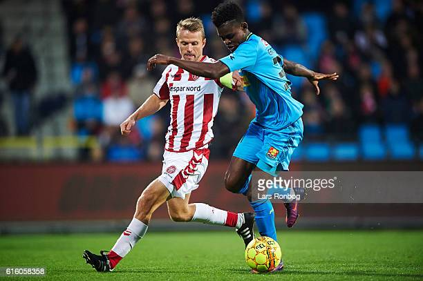 Rasmus Wurtz of AaB Aalborg and Godsway Donyoh of FC Nordsjalland compete for the ball during the Danish Alka Superliga match between AaB Aalborg and...