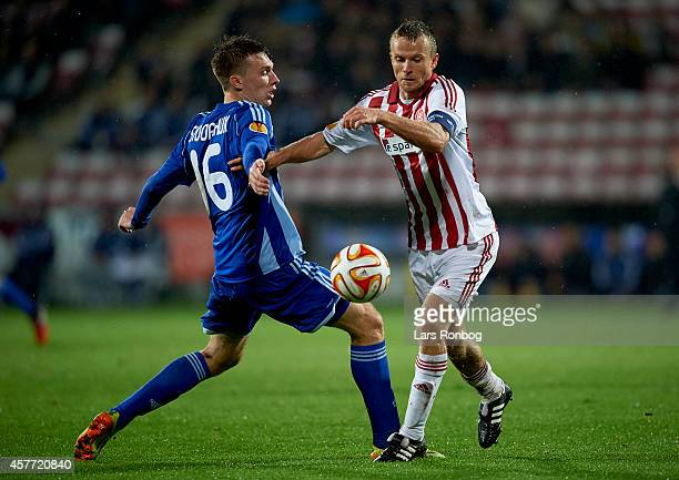 Rasmus Wurtz of AaB Aalborg and Serhiy Sydorchuk of Dynamo Kyiv compete for the ball duringthe UEFA Europa League match between AaB Aalborg and...