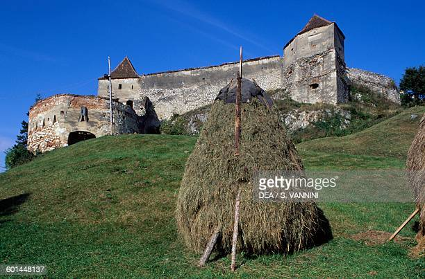 Rasnov's fortified citadel with a haystack in the foreground Transylvania Romania 13th century