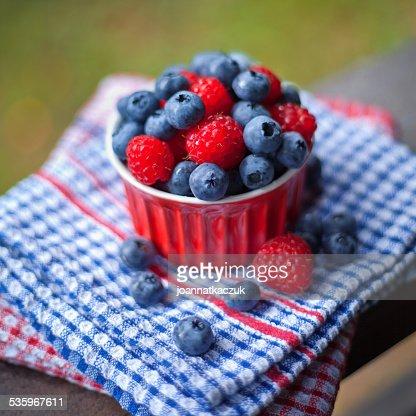 Raspberries and blueberries fruits. : Stock Photo