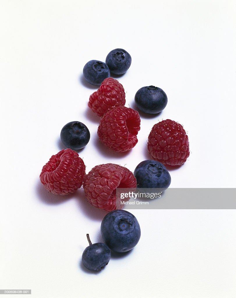 Raspberries and blueberries : Stock Photo