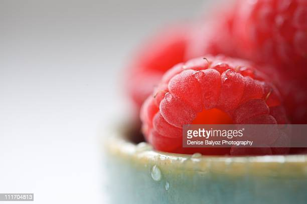 Raspberries in Green Ceramic Bowl with Water Drops