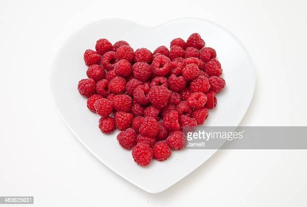 Raspberries on heart shaped plate