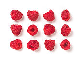 View from above of ripe red raspberry on white background. Organic raspberries creative layout pattern, isolated on white with clipping path. Top view or flat lay. Vegan food concept