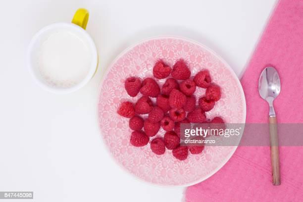 Raspberries, sugar and milk