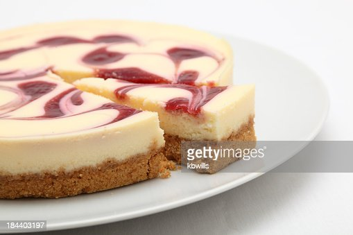 Raspberry cheesecake on a round white plate