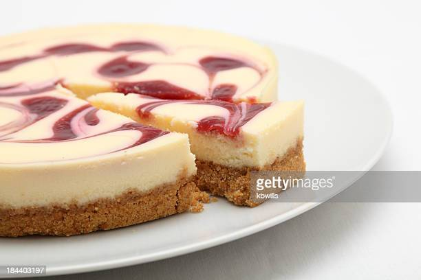 Raspberry cheesecake on a round white plate