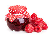 Raspberry jam and fresh berries isolated on white