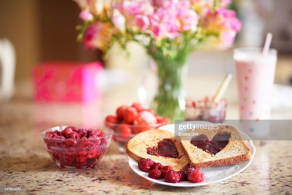 Raspberry jam hearts on toast : Stock Photo