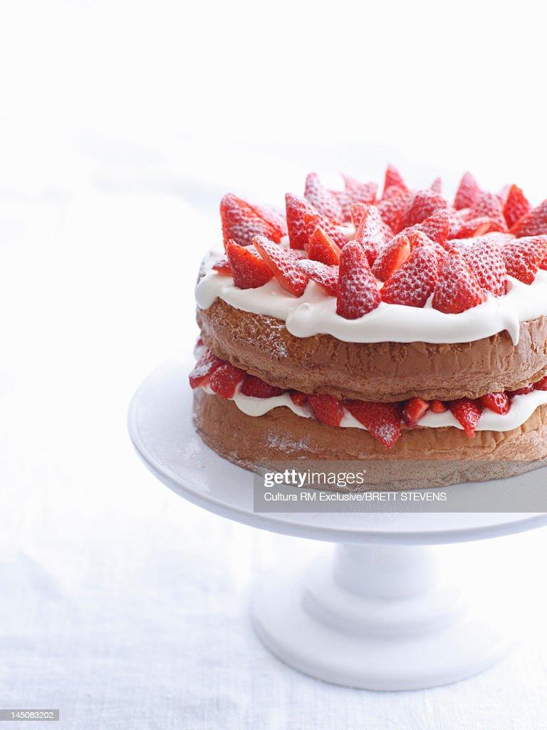 Raspberry layer cake on platter