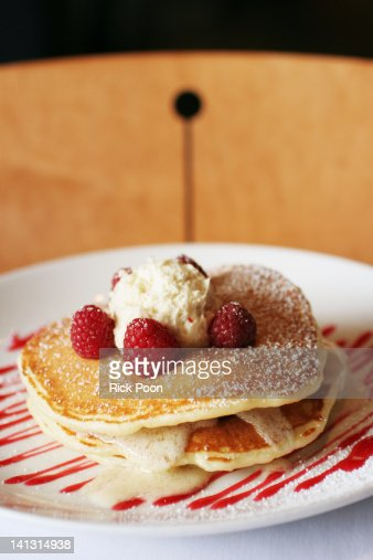 Raspberry pancakes with butter : Stock Photo