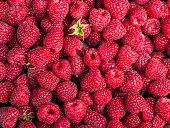 Many sweet fresh raspberry fruit closeup view background