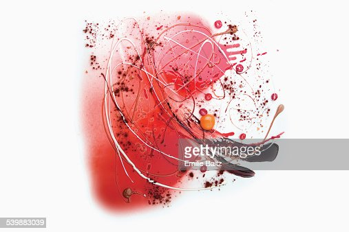 Raspberry sauce and coco powder spread over white background