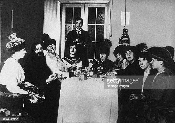 Rasputin at the meal among His Admirers