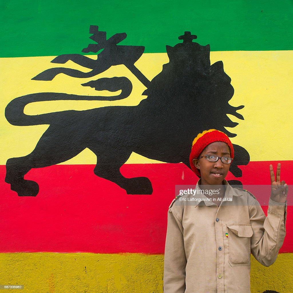 Rastafari girl called kizzy in front of a lion of judah mural oromo shashamane Ethiopia on March 23 2016 in Shashamane Ethiopia