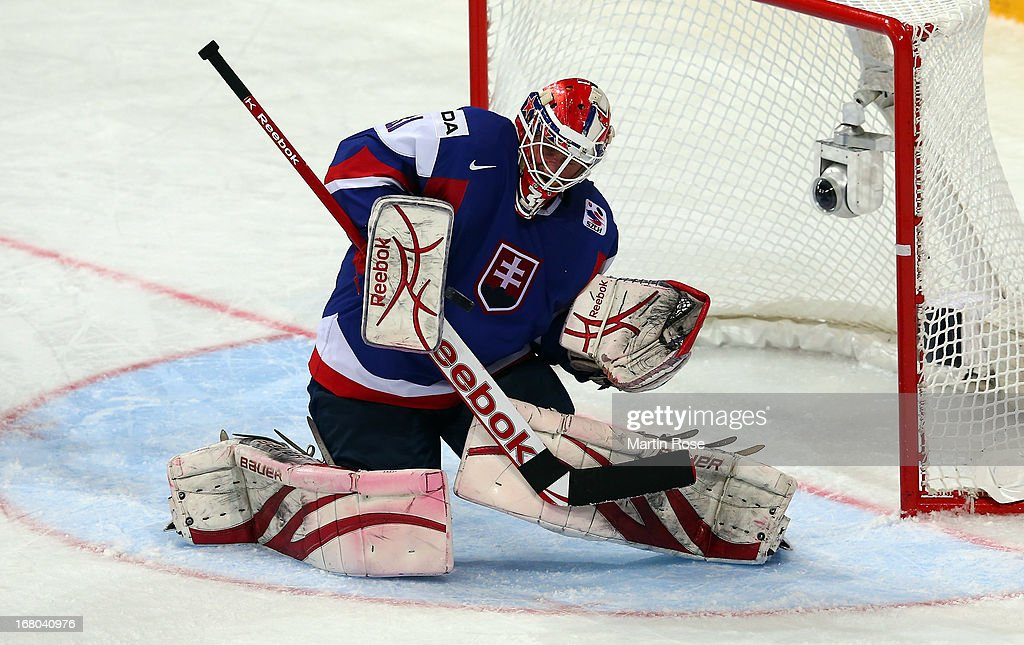 <a gi-track='captionPersonalityLinkClicked' href=/galleries/search?phrase=Rastislav+Stana&family=editorial&specificpeople=215502 ng-click='$event.stopPropagation()'>Rastislav Stana</a>, goaltender of Slovakia makes a save during the IIHF World Championship group H match between Finland and Slovakia at Hartwall Areena on May 4, 2013 in Helsinki, Finland.