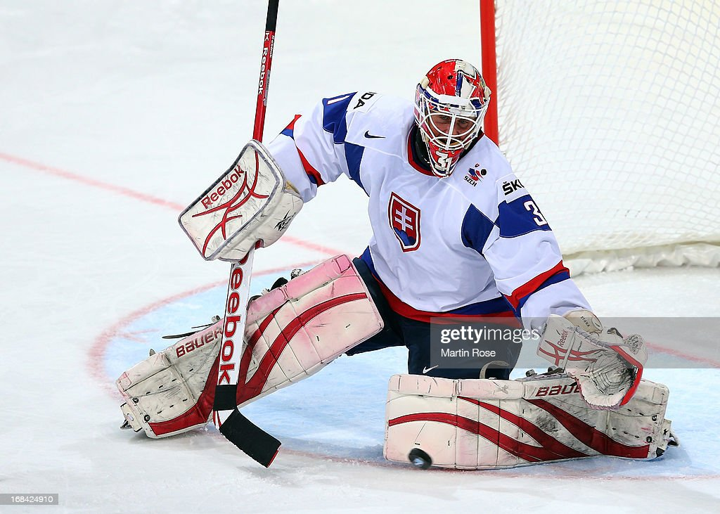 <a gi-track='captionPersonalityLinkClicked' href=/galleries/search?phrase=Rastislav+Stana&family=editorial&specificpeople=215502 ng-click='$event.stopPropagation()'>Rastislav Stana</a>, goaltender of Slovakia makes a save during the IIHF World Championship group H match between Russia and France at Hartwall Areena on May 9, 2013 in Helsinki, Finland.